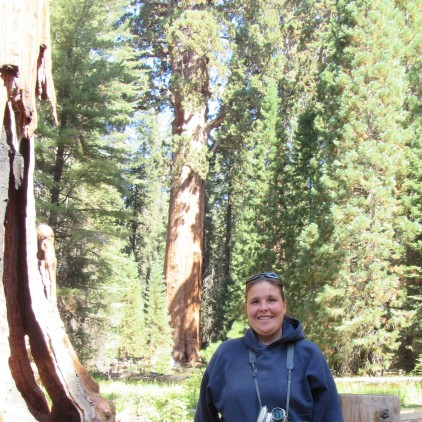 Erika Trailer-Perkins with the General Sherman Sequoia Tree behind her